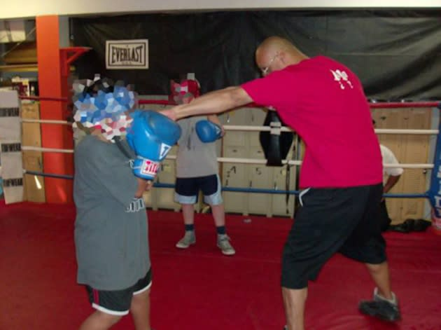 Anthony Serrano trains one of his boxing students at the Santa Ana Boxing Club — Facebook