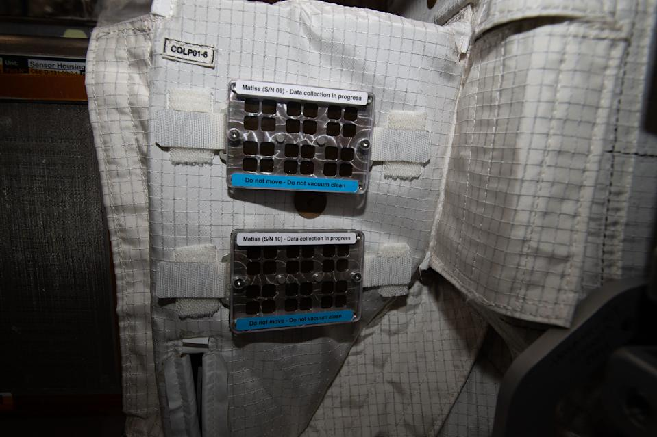 "A sign reading ""do not touch"" labels this Matiss experiment on board the International Space Station. The experiment tests the antibacterial capabilities of hydrophobic (water-repelling) surfaces on the space station. With experiments like this, researchers can learn more about how microscopic organisms like bacteria live in space and how the crew can keep the station clean of illness-causing microorganisms."