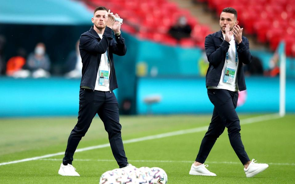 Scotland's Andrew Robertson (left) and John McGinn walk the pitch prior to the UEFA Euro 2020 Group D match at Wembley Stadium, London. - Nick Potts/PA Wire