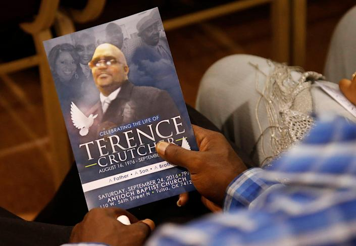A man holds a copy of the program for the funeral of Terence Crutcher during services to honor him in Tulsa, Oklahoma. Crutcher was fatally shot Sept. 16 by Tulsa police officer Betty Shelby.