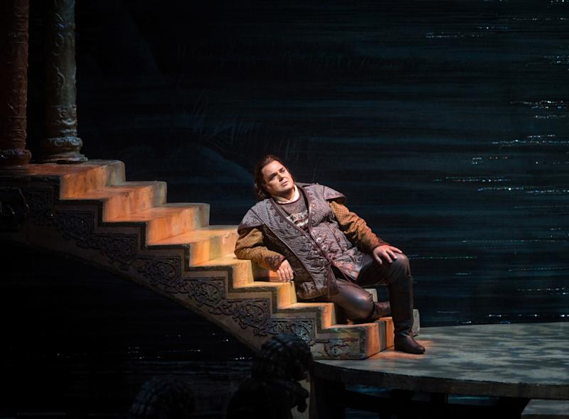 """This Sept. 14, 2012, photo provided by the Metropolitan Opera shows a scene from Puccini's """"Turandot,"""" with Marco Berti as Calàf during a dress rehearsal at the Metropolitan Opera in New York. (AP Photo/Metropolitan Opera, Marty Sohl)"""