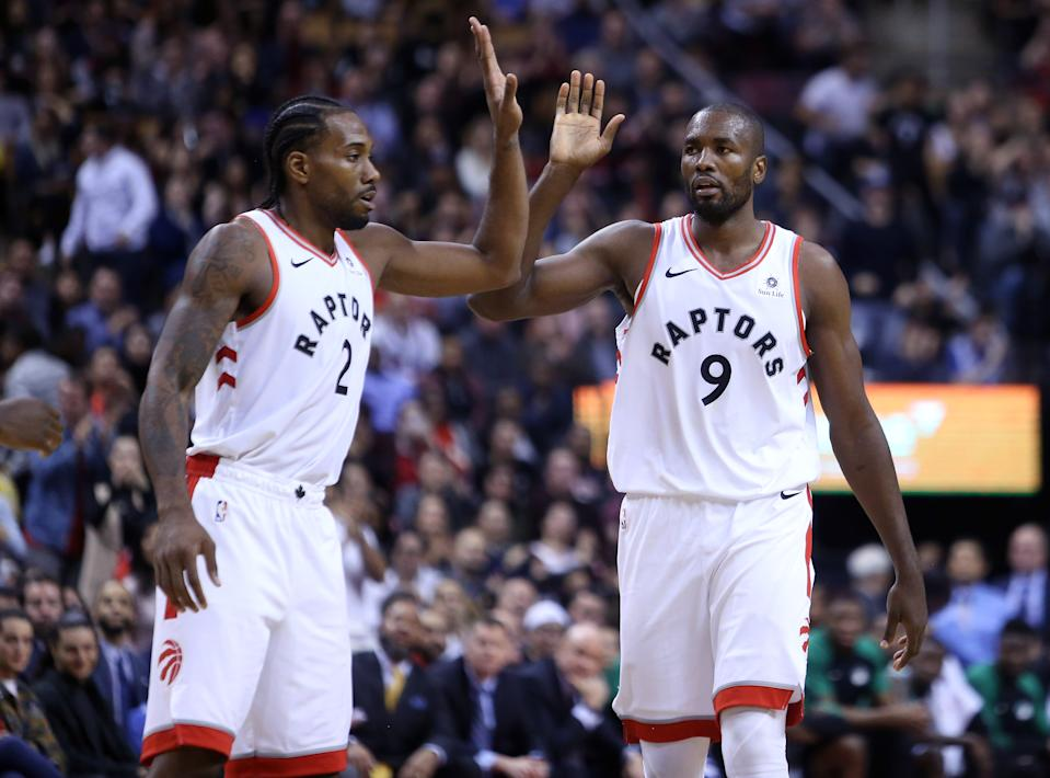 TORONTO, ON - OCTOBER 19:  Kawhi Leonard #2 and Serge Ibaka #9 of the Toronto Raptors react late in the second half of an NBA game against the Boston Celtics at Scotiabank Arena on October 19, 2018 in Toronto, Canada.  NOTE TO USER: User expressly acknowledges and agrees that, by downloading and or using this photograph, User is consenting to the terms and conditions of the Getty Images License Agreement.  (Photo by Vaughn Ridley/Getty Images)