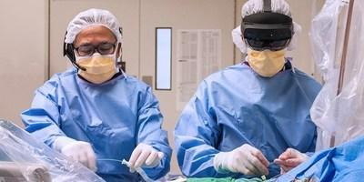 Cardiac surgeon Dr. Felix Ma, and cardiologist Dr. Ali Abualsaud  wearing HoloLens on the right. (CNW Group/Medtronic Canada ULC)