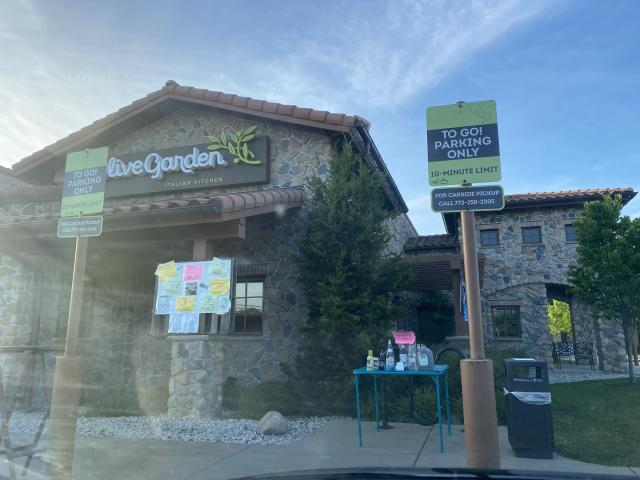 The blue table outside a Chicago-area Olive Garden is where all the action takes place. (Yahoo)
