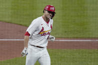 St. Louis Cardinals' Jack Flaherty smiles after hitting a solo home run during the third inning of a baseball game against the Colorado Rockies Friday, May 7, 2021, in St. Louis. (AP Photo/Jeff Roberson)