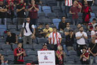 A fan holds a sign with the name of referee Sapir Berman during an Israeli Premier League soccer match between Hapoel Haifa and Beitar Jerusalem in the northern Israeli city of Haifa, Monday, May 3, 2021. Israeli soccer's first transgender soccer referee took the field Monday for the first time since coming out publicly as a woman last week. (AP Photo/Sebastian Scheiner)