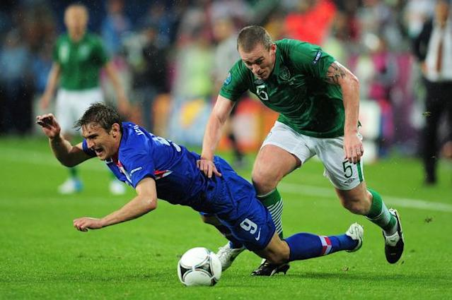POZNAN, POLAND - JUNE 10: Nikica Jelavic of Croatia clashes with Richard Dunne of Republic of Ireland during the UEFA EURO 2012 group C between Ireland and Croatia at The Municipal Stadium on June 10, 2012 in Poznan, Poland. (Photo by Jamie McDonald/Getty Images)