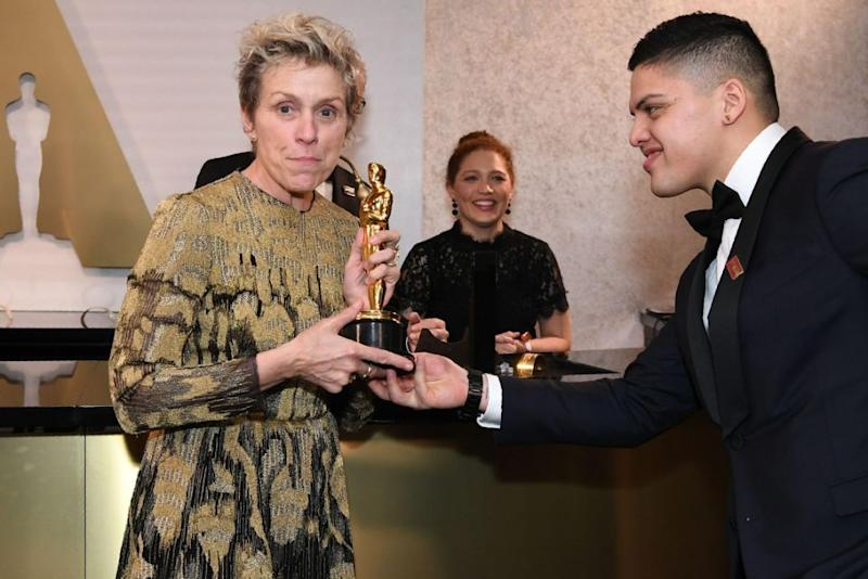 Frances McDormand poses with her Oscar after getting it engraved at the Governors Ball. Source: Getty Images