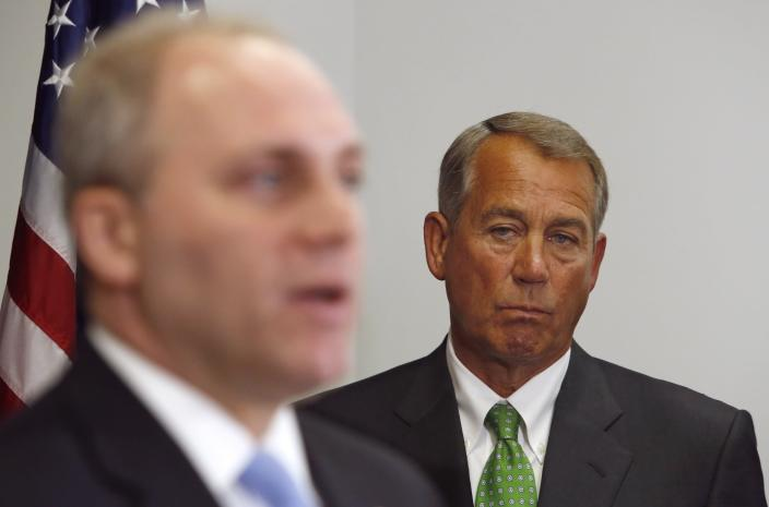 U.S. House Speaker John Boehner (R-OH) (R) listens to remarks by Republican Whip Representative Steve Scalise (R-LA) (L) at a news conference following a Republican caucus meeting at the U.S. Capitol in Washington January 7, 2015. The campaign manager of a Democrat who challenged Scalise tipped off a blogger that the Republican lawmaker had spoken to a white supremacist group in 2002. REUTERS/Jonathan Ernst (UNITED STATES - Tags: POLITICS)