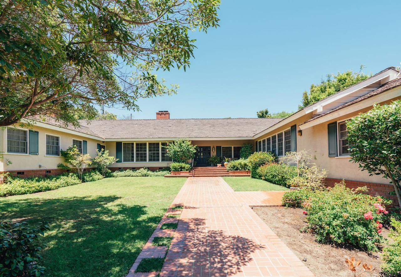 <p>Located in one of L.A.'s most exclusive enclaves, the 4,600 square foot ranch-style house was built in 1938, and features a semi-open floor plan with four bedrooms, four bathrooms, and a two car garage. </p>