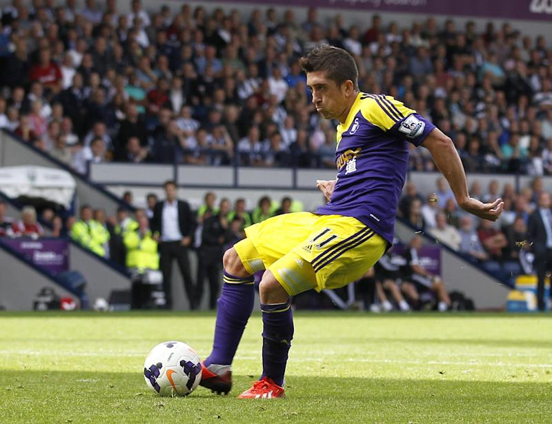 Swansea City's Spanish midfielder Pablo Hernandez scores a goal at home against West Bromwich Albion on September 1, 2013