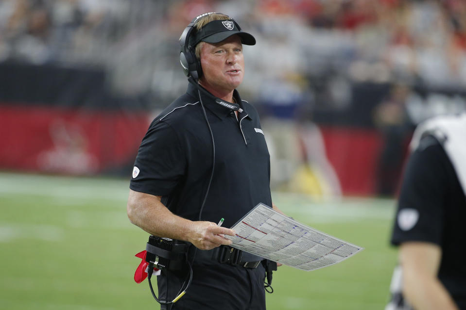"""FILE - In this Aug. 15, 2019, file photo, Oakland Raiders head coach Jon Gruden is shown during an NFL preseason football game against the Arizona Cardinals in Glendale, Ariz. The Raiders worldwide tour gets started in the preseason when they play a """"home"""" exhibition against Green Bay in Winnipeg on Thursday, Aug. 22. (AP Photo/Rick Scuteri, File)"""