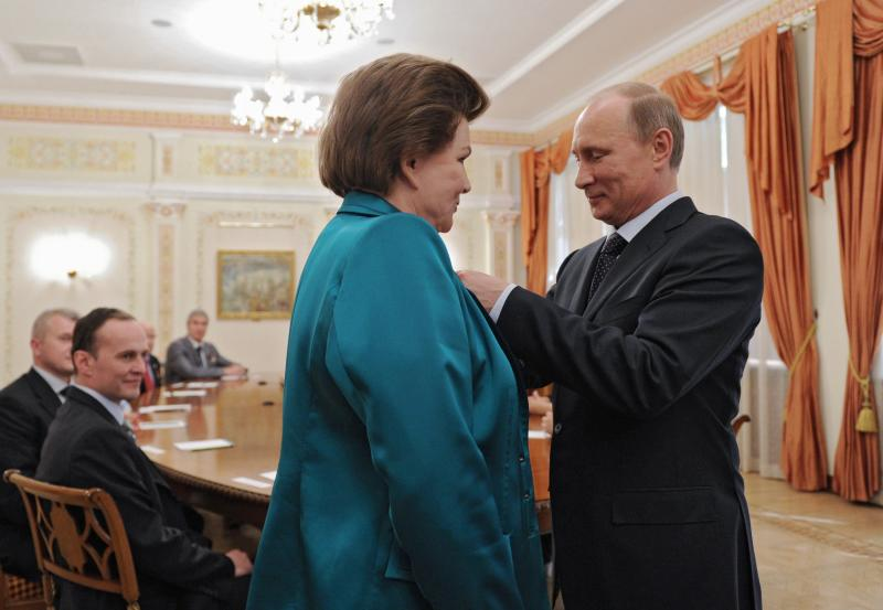 Russian President Vladimir Putin awards cosmonaut Valentina Tereshkova, the first woman in space, with the Order of Alexander Nevsky in the Novo-Ogaryovo residence outside Moscow, Friday, June 14, 2013. Putin met with Russian cosmonauts to mark the 50th anniversary of Tereshkova's flight. (AP Photo/RIA-Novosti, Mikhail Klimentyev, Presidential Press Service)