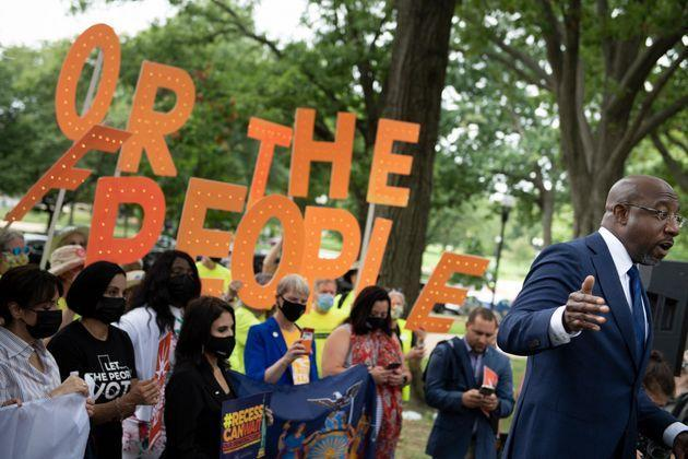 U.S. Sen. Raphael Warnock (D-Ga.) speaks to people rallying for voters' rights on Capitol Hill on Aug. 3, 2021. (Photo: BRENDAN SMIALOWSKI via Getty Images)