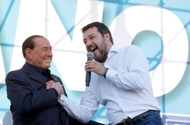 League party leader Matteo Salvini welcomes former Italian Prime Minister Silvio Berlusconi on stage during an anti-government demonstration in Rome, Italy, October 19, 2019. REUTERS/Remo Casilli