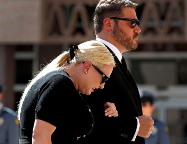 PHOTO: Meghan McCain cries as she and her husband Ben Domenech follow behind the casket carrying her father Sen. John McCain as they arrive for a memorial service, Aug. 29, 2018, at the Capitol in Phoenix. (Matt York/AP)