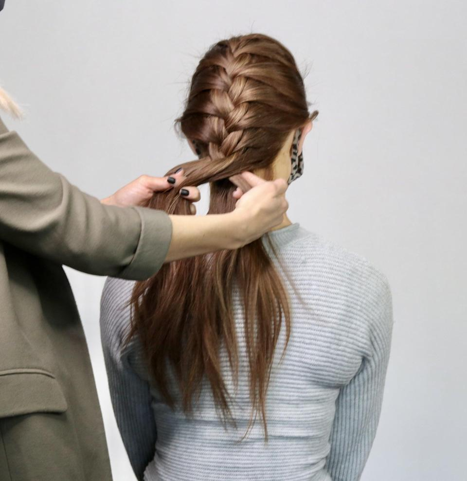 <p>Repeat by gathering small pieces of hair from either side of your head, gathering it into the braid each time while working your way down until you get to the nape of the neck.</p>