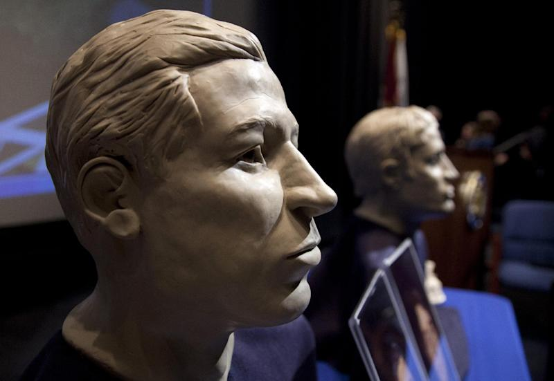 FILE - In this March 6, 2012 file photo, phases of facial reconstruction of the two sailors of the Civil War ironclad USS Monitor, older is at left, are on display in the auditorium of the United States Navy Memorial in Washington. The remains of the two unknown Union sailors recovered from the Civil War ironclad USS Monitor will be interred in Arlington National Cemetery on March 8. A century and a half after the USS Monitor sank, the interment of remains of two unknown sailors found in the Civil War ironclad's turret is bringing together nearly 100 people from Maine to California who have a distant familial tie to the 16 Union sailors who died when the ship went down. (AP Photo/Carolyn Kaster, File)