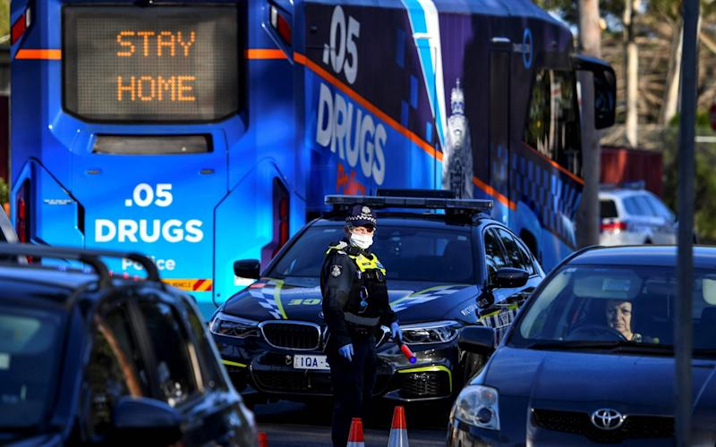 Police pull vehicles aside at a checkpoint in the locked-down suburb of Broadmeadows in Melbourne - WILLIAM WEST/AFP via Getty Images