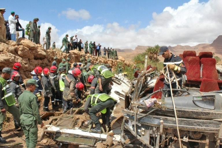 Moroccan rescuers search for bodies after floods overturned a bus on September 8 in the kingdom's southeast