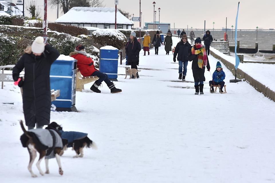 SOUTHEND, ENGLAND - FEBRUARY 11: People walk along the promenade at Chalkwell beach after more snow fell overnight on February 11, 2021 in Southend on Sea, England. Storm Darcy brought heavy snow in Scotland and South East England over last weekend which kick started a week of freezing temperatures across many parts of the UK. (Photo by John Keeble/Getty Images)