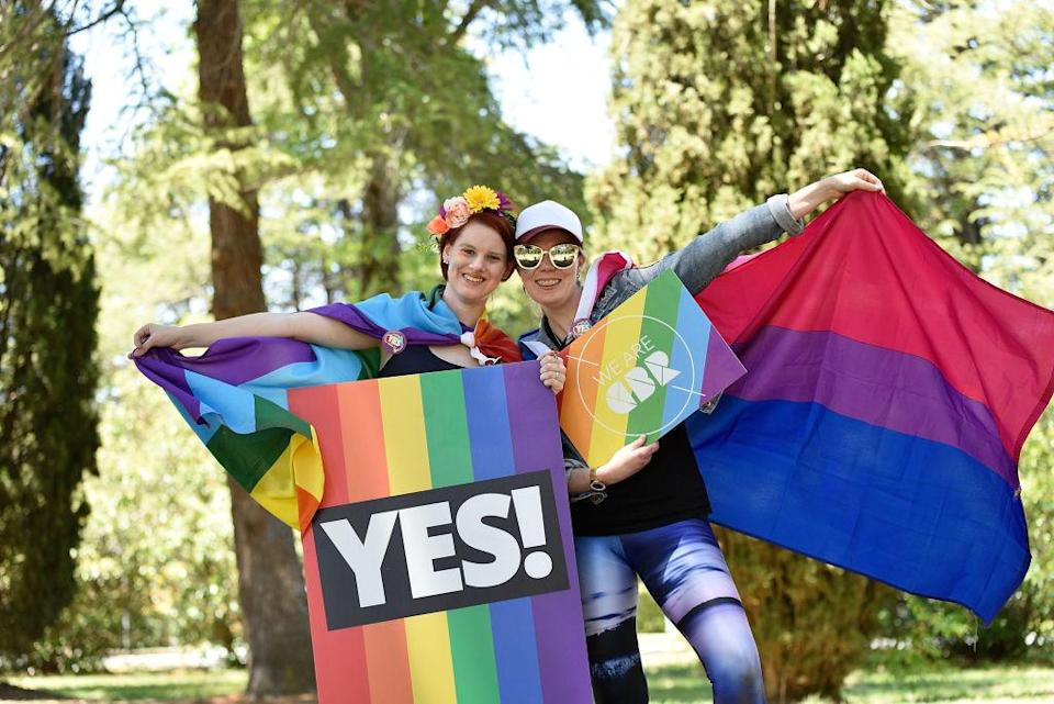 <p>Supporters of the vote yes for marriage equality gather in Haig Park to celebrate the result in Canberra, Australia. Australians have voted for marriage laws to be changed to allow same-sex marriage, with the Yes vote claiming 61.6 percent to to 38.4 percent for No vote. Despite the Yes victory, the outcome of Australian Marriage Law Postal Survey is not binding, and the process to change current laws will move to the Australian Parliament in Canberra. (Michael Masters/Getty Images) </p>