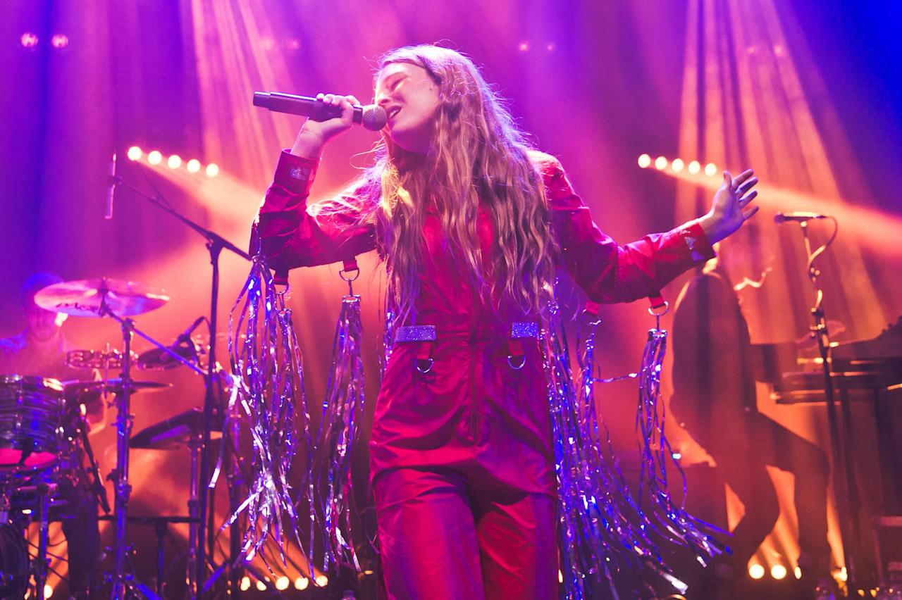 <p>She looks ready to party in this red jumpsuit with metallic fringe. </p>