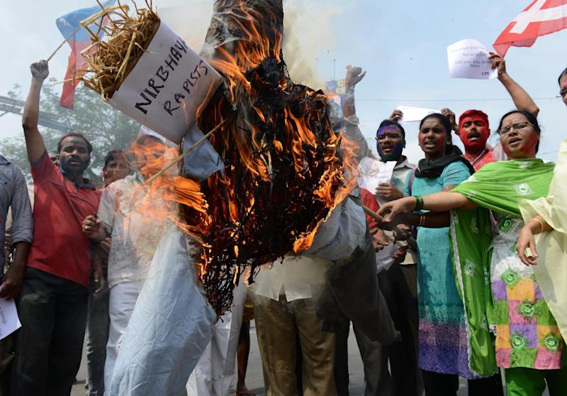 Activists burn an effigy representing the rapists involved in the 2012 attack on Delhi student 'Nirbhaya': AFP/Getty Images