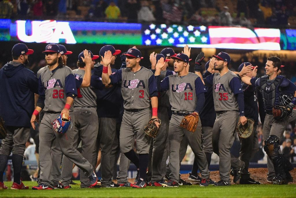 Team USA celebrate their 2-1 win over Japan at the end of the ninth inning in Game 2 of the Championship Round of the 2017 World Baseball Classic, at Dodger Stadium in Los Angeles, on March 21 (AFP Photo/Harry How)