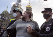 Police detain a protester during a rally supporting Khabarovsk region's governor Sergei Furgal in St.Petersburg, Russia, Saturday, Aug. 1, 2020. Thousands of demonstrators rallied Saturday in the Russian Far East city of Khabarovsk to protest the arrest of the regional governor, continuing a three-week wave of opposition that has challenged the Kremlin. (AP Photo/Dmitri Lovetsky)
