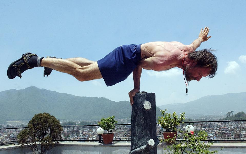 "Dutchman Wim Hof, better known as ""Iceman"" for his ability to withstand seemingly impossible levels of cold, demonstrates at a hotel in Kathmandu, 28 May 2007.   'Iceman', who failed in his attempt to conquer Mount Everest wearing just shorts vowed to have another half-naked crack at the world's highest peak next year. Hof said that next year he would try Everest again, and then with a paraglider and two French people they would fly down.  AFP PHOTO/DEVENDRA M.SINGH (Photo credit should read DEVENDRA MAN SINGH./AFP via Getty Images)"