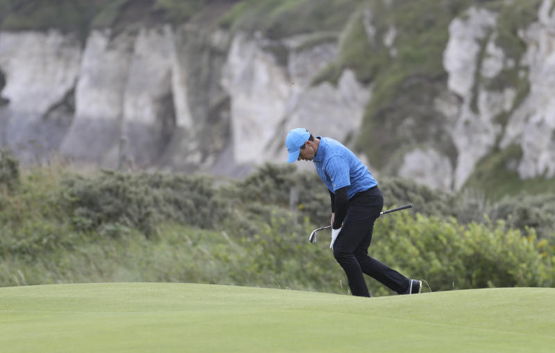 Northern Ireland's Rory McIlroy reacts after missing a shot on then 5th green during the first round of the British Open Golf Championships at Royal Portrush in Northern Ireland, Thursday, July 18, 2019.(AP Photo/Peter Morrison)