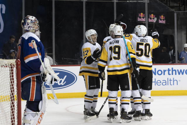 New York Islanders goaltender Semyon Varlamov stands in front of the net as the Pittsburgh Penguins celebrate after a goal by center Evgeni Malkin (71) during the third period of an NHL hockey game Thursday, Nov. 7, 2019, in New York. The Penguins won 4-3. (AP Photo/Mary Altaffer)