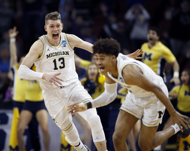 Michigan guard Jordan Poole (2) is chased by forward Moritz Wagner (13) after his 3-pointer to beat Houston last weekend (AP)