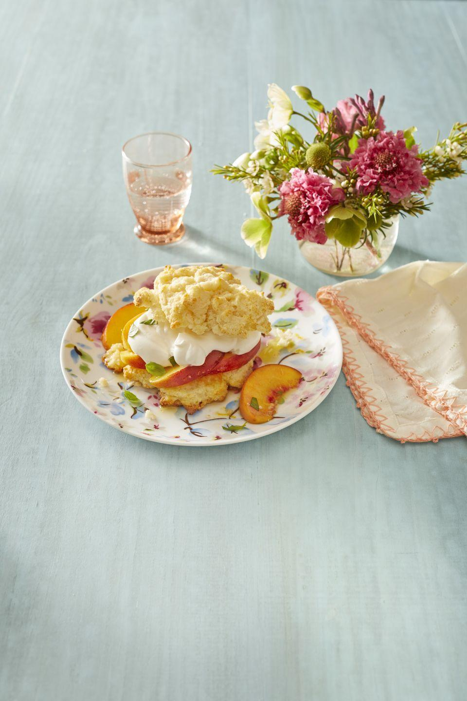 """<p>You've had strawberry shortcake—now give this peach version a try! The basil adds extra fresh flavor. </p><p><a href=""""https://www.thepioneerwoman.com/food-cooking/recipes/a32096313/peaches-and-cream-shortcake-basil-recipe/"""" rel=""""nofollow noopener"""" target=""""_blank"""" data-ylk=""""slk:Get Ree's recipe."""" class=""""link rapid-noclick-resp""""><strong>Get Ree's recipe.</strong></a></p><p><a class=""""link rapid-noclick-resp"""" href=""""https://go.redirectingat.com?id=74968X1596630&url=https%3A%2F%2Fwww.walmart.com%2Fsearch%2F%3Fquery%3Dpioneer%2Bwoman%2Bplates&sref=https%3A%2F%2Fwww.thepioneerwoman.com%2Ffood-cooking%2Frecipes%2Fg36382592%2Fpeach-desserts%2F"""" rel=""""nofollow noopener"""" target=""""_blank"""" data-ylk=""""slk:SHOP PLATES"""">SHOP PLATES</a></p>"""