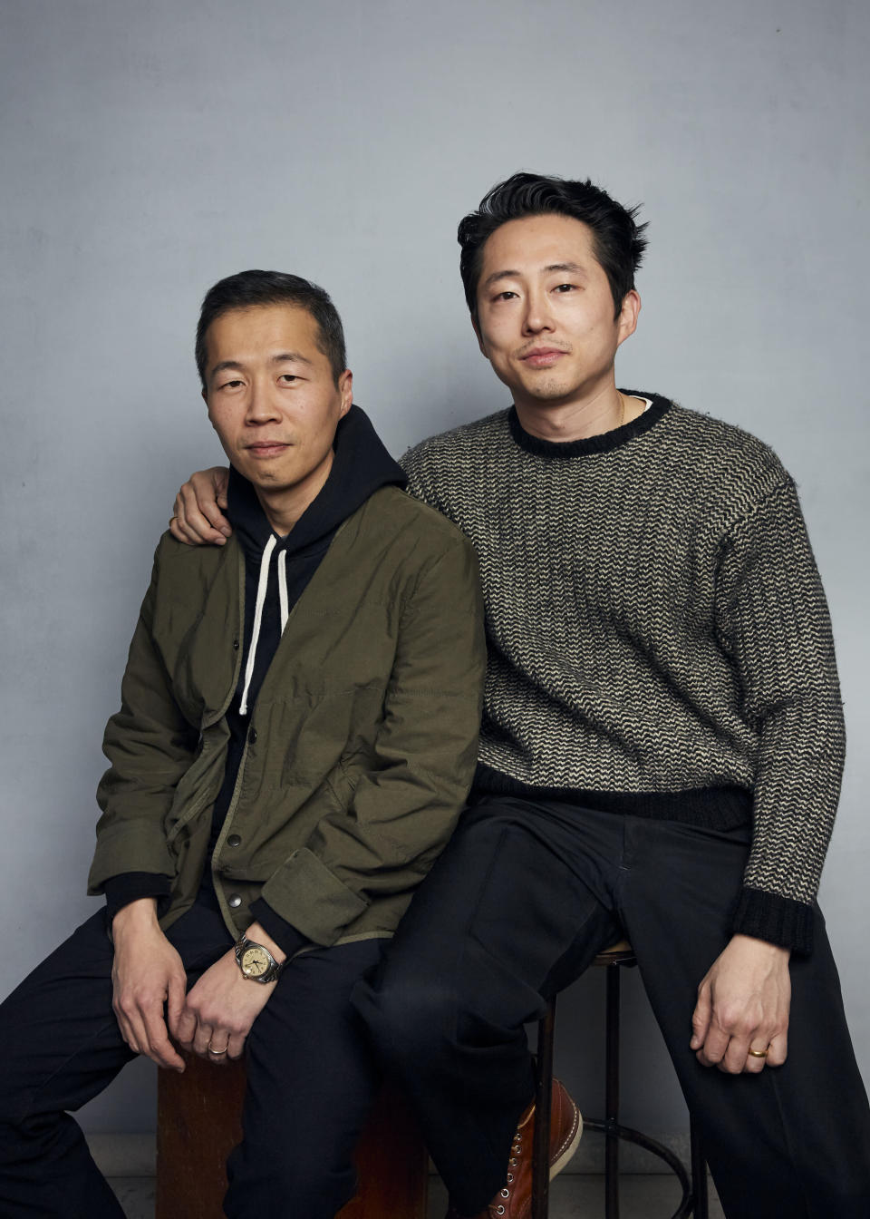 """FILE- Director Lee Isaac Chung, left, and Steven Yeun pose for a portrait to promote the film """"Minari"""" during the Sundance Film Festival in Park City, Utah on Jan. 27, 2020. (Photo by Taylor Jewell/Invision/AP, File)"""