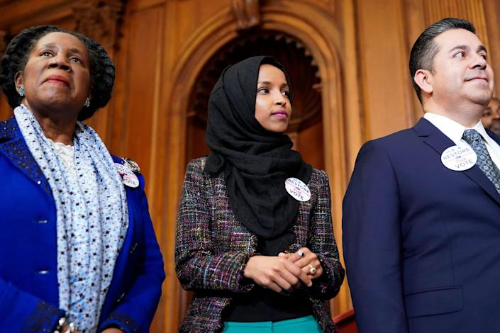 Rep. Ilhan Omar, D-Minn., joins lawmakers to speak about the Voting Rights Enhancement Act on Feb. 26, 2019, in Washington,
