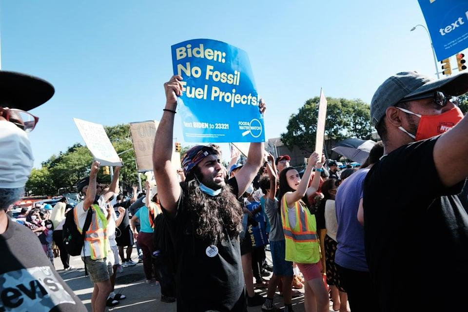 Protesters picketed Joe Biden's appearance in Queens on 7 September to demand his administration take more aggressive action to stop fossil fuel production. (Getty Images)