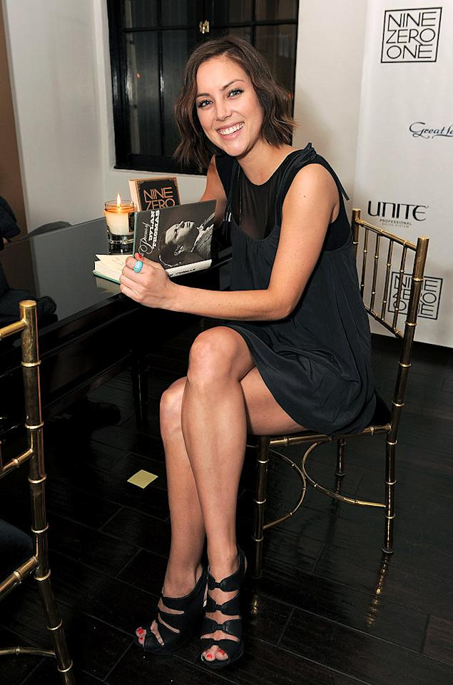 """AnnaLynne's castmate on the Beverly Hills-based show, Jessica Stroup, flipped through a Dylan Thomas book in a luxe lounge area. <a href=""""http://ninezeroonesalon.com/index.htm"""">The salon's website</a> says guests also have the option of using laptops or HD TVs and sipping on complimentary champagne while waiting for services. Jordan Strauss/<a href=""""http://www.wireimage.com"""" target=""""new"""">WireImage.com</a> - February 22, 2010"""
