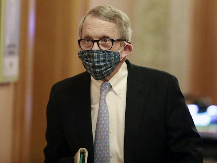 Ohio governor Mike DeWine wears a face masks on his way to news conference in Columbus, Ohio, on 16 April, 2020: Doral Chenoweth/The Columbus Dispatch via AP