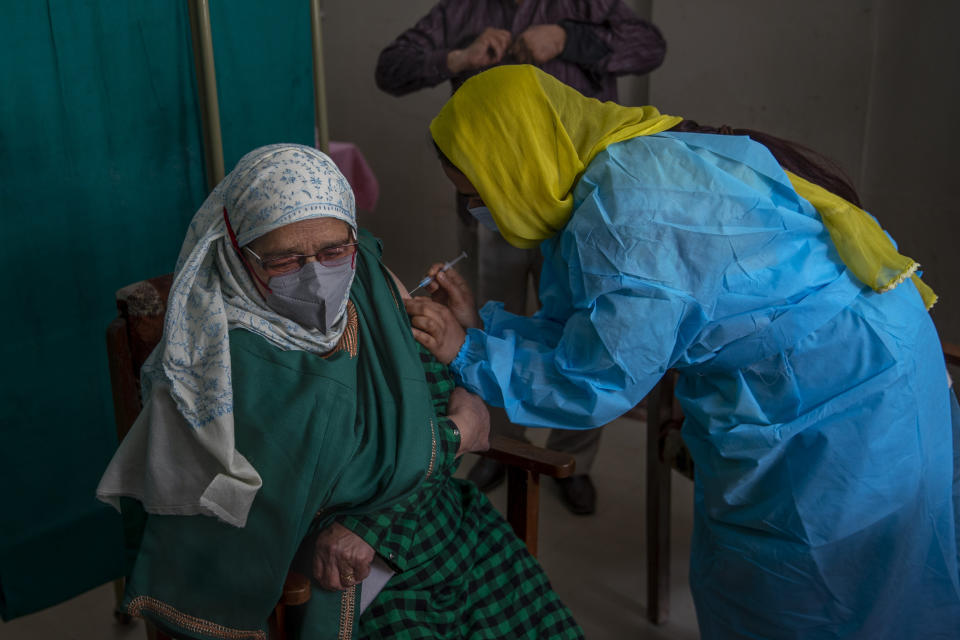 An elderly Kashmiri Ameena Begum receives the Covishield vaccine for COVID-19 at a primary health center in Srinagar, Indian controlled Kashmir, Friday, March 19, 2021. India is third behind the United States and Brazil in total coronavirus infections. (AP Photo/Dar Yasin)