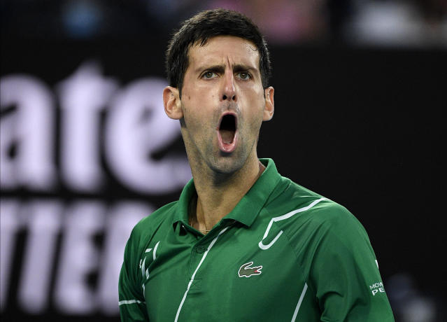 Serbia's Novak Djokovic reacts during his men's singles final against Austria's Dominic Thiem at the Australian Open tennis championship in Melbourne, Australia, Sunday, Feb. 2, 2020. (AP Photo/Andy Brownbill)
