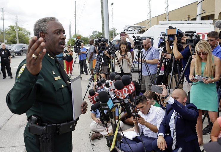 Orange County Sheriff Jerry Demings, left, answers questions at a news conference near the scene of a shooting where there were multiple fatalities in an industrial area near Orlando, Fla., Monday, June 5, 2017. (Photo: John Raoux/AP)