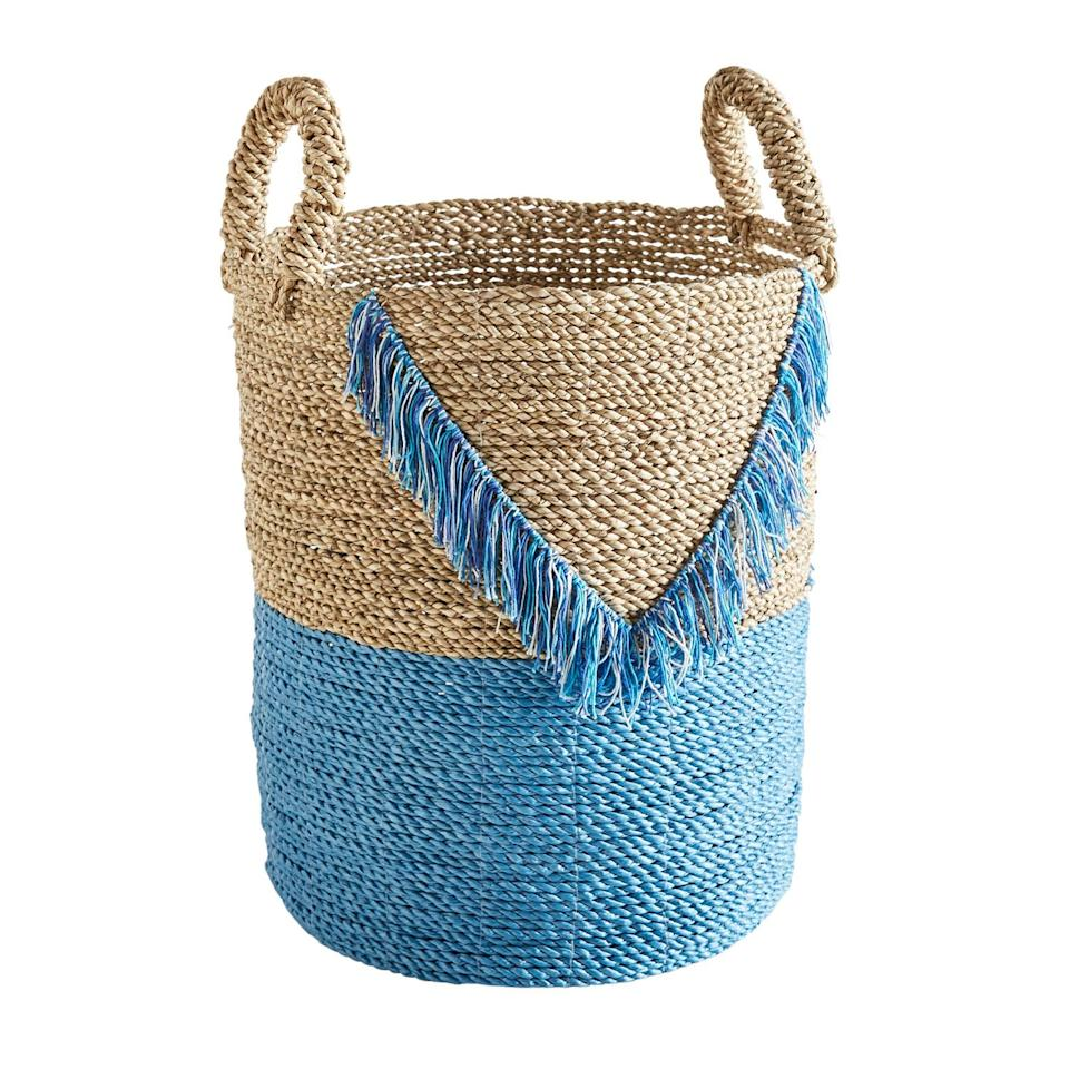 """<p>Woven out of seagrass, the <a href=""""https://www.popsugar.com/buy/Blue-Fringe-Basket-472265?p_name=Blue%20Fringe%20Basket&retailer=pier1.com&pid=472265&price=40&evar1=casa%3Aus&evar9=46420058&evar98=https%3A%2F%2Fwww.popsugar.com%2Fhome%2Fphoto-gallery%2F46420058%2Fimage%2F46420079%2FBlue-Fringe-Basket&list1=pier%201%2Cdecor%20shopping%2C50%20under%20%2450&prop13=mobile&pdata=1"""" rel=""""nofollow"""" data-shoppable-link=""""1"""" target=""""_blank"""" class=""""ga-track"""" data-ga-category=""""Related"""" data-ga-label=""""https://www.pier1.com/blue-fringe-basket/3923907.html?cgid=baskets#nav=left&amp;origin=gridswatch"""" data-ga-action=""""In-Line Links"""">Blue Fringe Basket</a> ($40) adds a pop of color anywhere it's placed.</p>"""