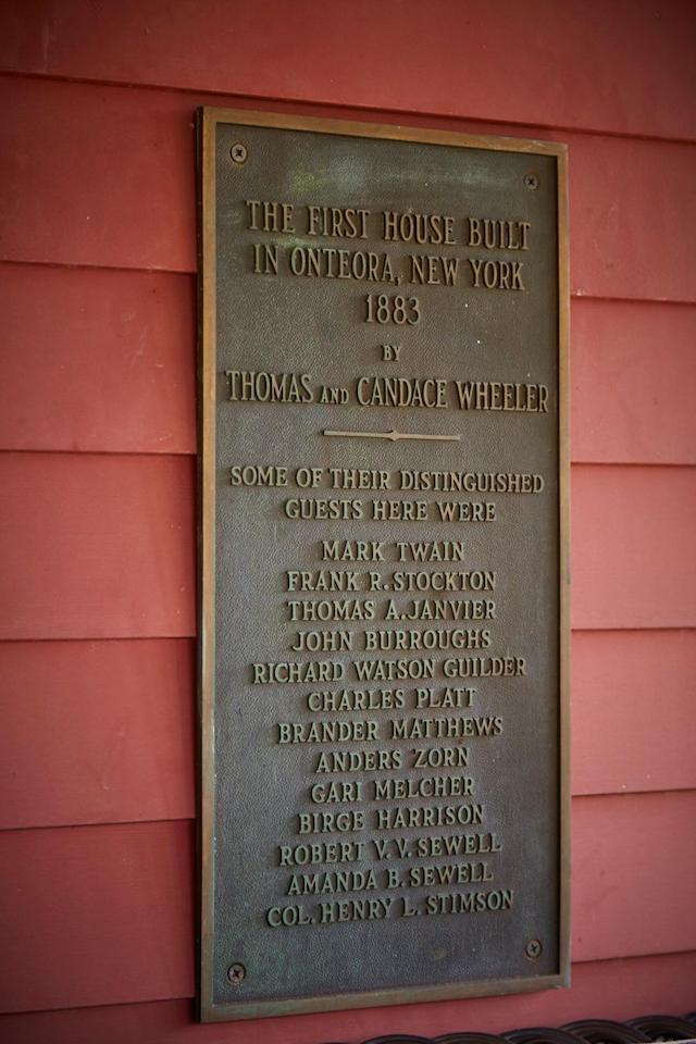 <p>A commemorative plaque on the home's exterior names various artists and writers-including Mark Twain and John Burroughs-who visited the home over the years. </p>
