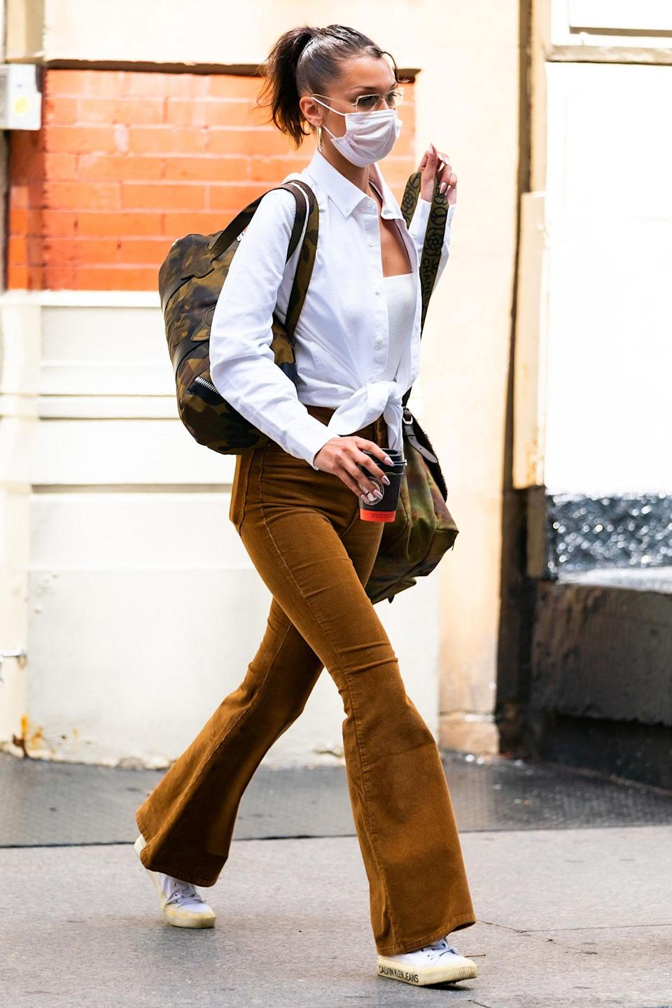 <p>Bella Hadid was seen out in New York City with her packed bags and face mask.</p>