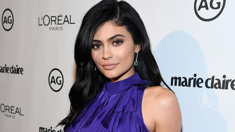 Kylie Jenner 'Strolls' With Daughter Stormi in Matching Designer Looks