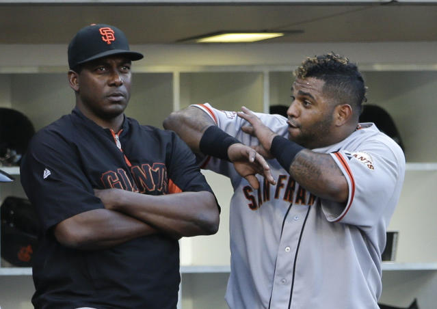 San Francisco Giants' Pablo Sandoval, right, jokes with batting coach Hensley Meulens after hitting a second home run hit of abaseball game against the San Diego Padres during the eighth inning on Wednesday, Sept. 4, 2013, in San Diego. (AP Photo/Gregory Bull)
