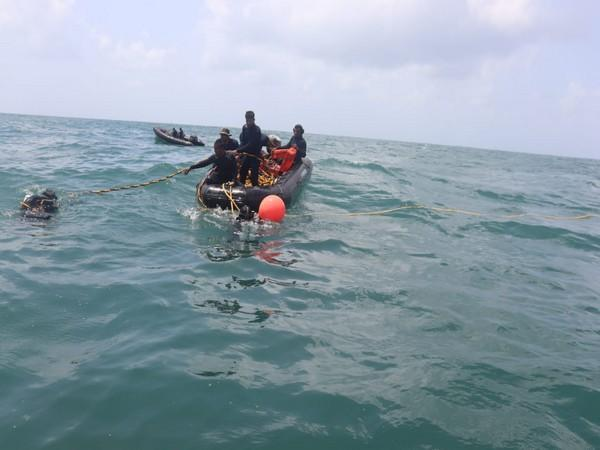 INS Makar conducts diving operations on the wreck of tug Varaprada on Monday. [Photo/ANI]