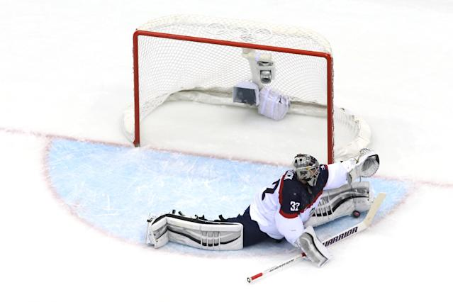 SOCHI, RUSSIA - FEBRUARY 21: Jonathan Quick #32 of the United States makes a save against Canada during the Men's Ice Hockey Semifinal Playoff on Day 14 of the 2014 Sochi Winter Olympics at Bolshoy Ice Dome on February 21, 2014 in Sochi, Russia. (Photo by Martin Rose/Getty Images)